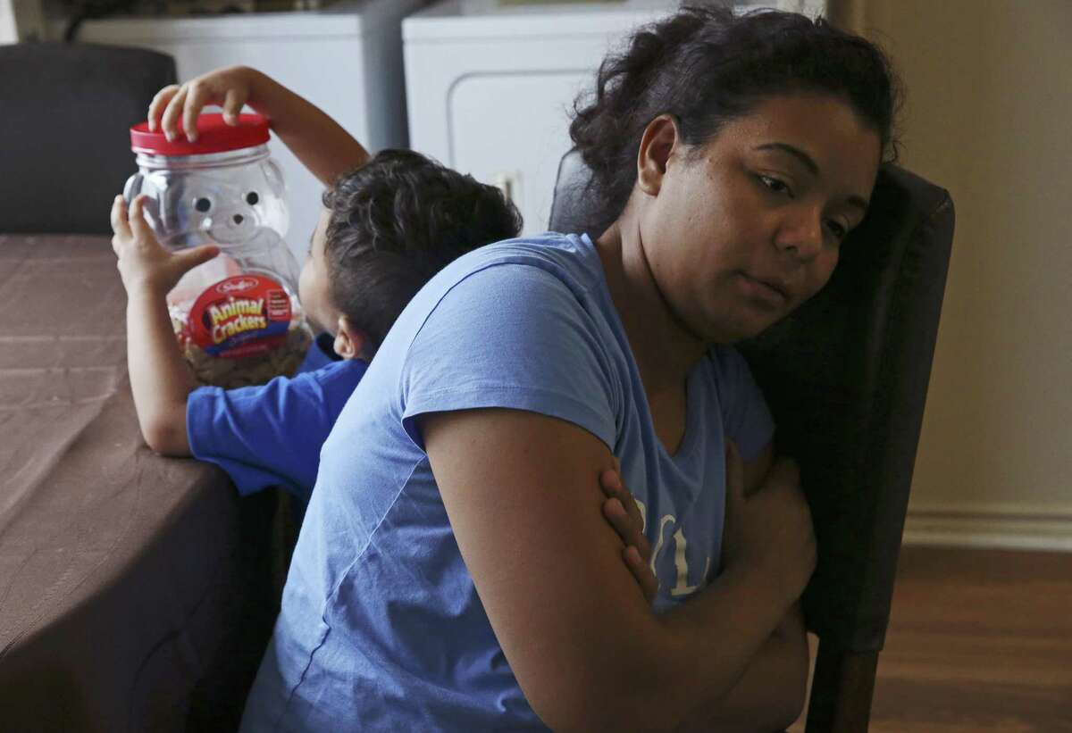 Evelyn Zepeda, 30, takes care of her four-year-old brother, Erik, at their apartment in Austin, Texas, Wednesday, Sept. 5, 2018. Erik and his mother, Josefina Ortiz Corralez, were separated when they presented themselves at a South Texas international bridge, seeking asylum in December of last year. According to Corralez, she adopted Erick as a newborn. Since then, the boy was released to Zepeda who also takes care of her six-year-old son with her overnight shift at a tortilla factory in Austin. Zepeda is also going to the process of seeking asylum and is appealing the latest ruling of an immigration court.
