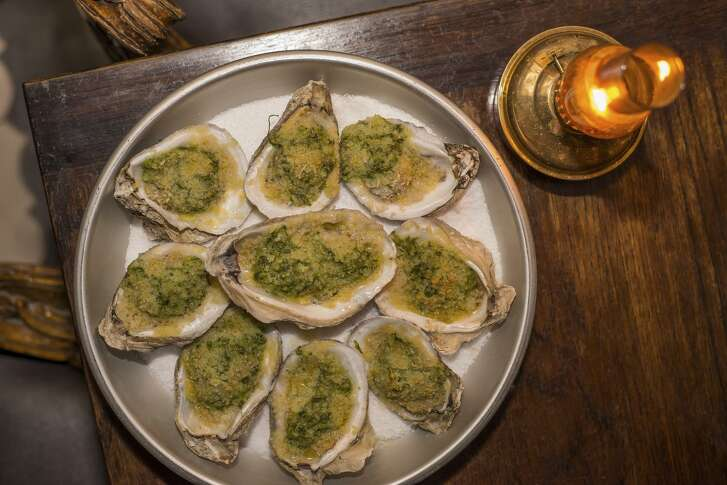 An order of Oysters Rockefeller at Downstairs at The Esquire. Downstairs at The Esquire Tavern is turning two this week, and to celebrate, the basement bar has put together a special beverage pairing menu that will be available today through Saturday.