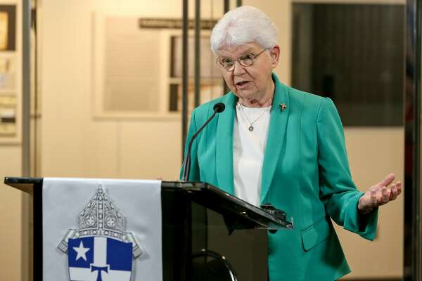 """Sister Jane Ann Slater, CDP, speaks during the grand opening of the remodeled Archives of the Archdiocese of San Antonio and a tour highlighting the many treasures there, including the """"1703 Baptismal Book,"""" at the Archdiocese of San Antonio Pastoral Center on Tuesday, Sept. 18, 2018."""