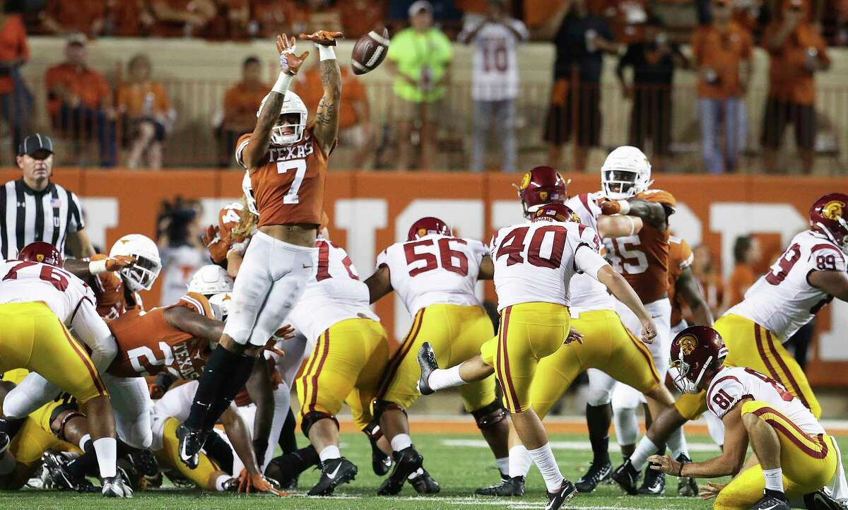Caden Stern gets up to block a field goal attempt in the second half which resulted in a run back touchdown for the Longhorns as UT plays USC at DKR Stadium on September 15, 2018.