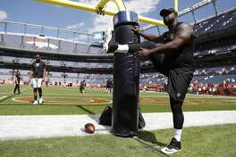 Oakland Raiders defensive tackle Clinton McDonald stretches prior to an NFL football game against the Denver Broncos, Sunday, Sept. 16, 2018, in Denver. (AP Photo/David Zalubowski)