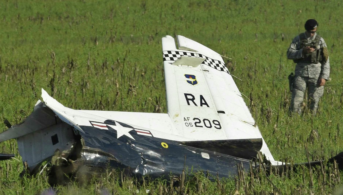 The wreckage of an Air Force T-6 Texan II trainer airplane is scattered on a field near Holy Cross Cemetery by Rolling Oaks Mall on Tuesday, Sept. 18, 2018.