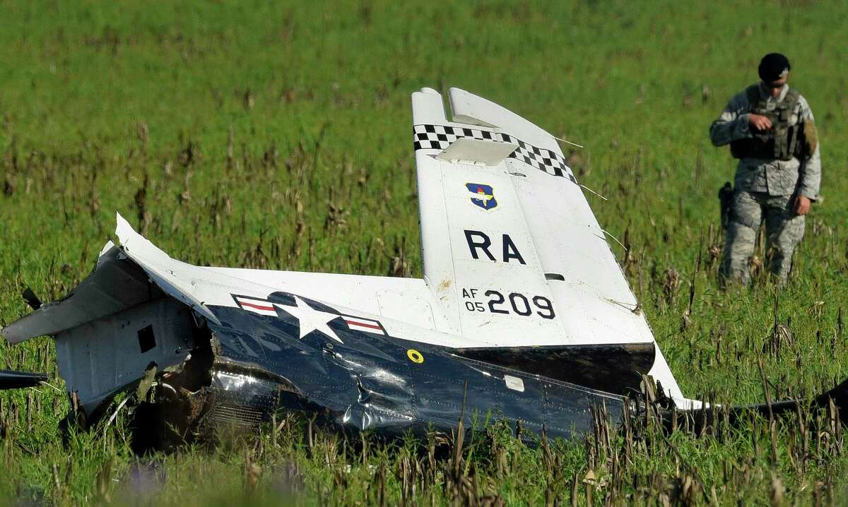 The wreckage of an Air Force T-6 Texan II trainer airplane is scattered on a field near Holy Cross Cemetery by Rolling Oaks Mall after it crashed Sept. 18, 2018. Both pilots ejected safely.