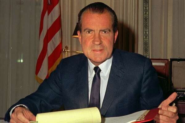President Richard M. Nixon at his desk in the White House in 1969.