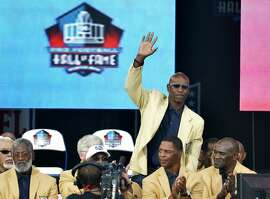 "FILE - In this Aug. 2, 2014, file photo, enshrinee Eric Dickerson is introduced during the Pro Football Hall of Fame enshrinement ceremony, in Canton, Ohio. A group of Pro Football Hall of Famers is demanding health insurance coverage and a share of NFL revenues or else those former players will boycott the induction ceremonies. In a letter sent to NFL Commissioner Roger Goodell, NFLPA Executive Director DeMaurice Smith and Hall of Fame President David Baker � and obtained by The Associated Press � 21 Hall of Fame members cited themselves as ""integral to the creation of the modern NFL, which in 2017 generated $14 billion in revenue."" Among the signees were Eric Dickerson. (AP Photo/David Richard, File)"