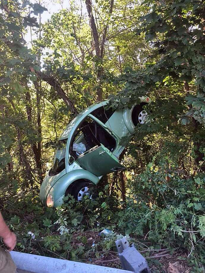 A crash left one car off the road and in the woods in Trumbull, Conn., on Sept. 16, 2018. Photo: Contributed Photo / Trumbull Volunteer Fire Department / Contributed Photo / Connecticut Post Contributed
