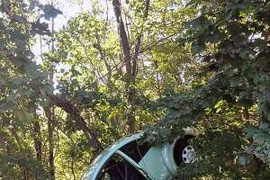 A crash left one car off the road and in the woods in Trumbull, Conn., on Sept. 16, 2018.
