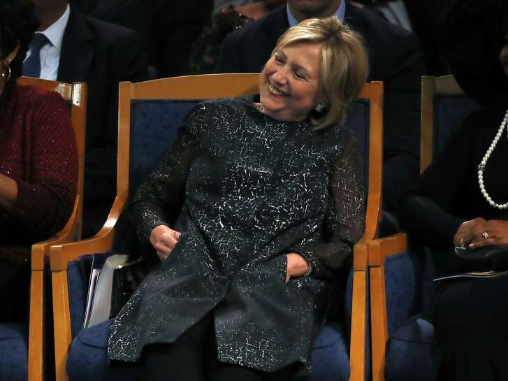 Hillary Clinton laughs as former President Bill Clinton speaks during the funeral service for Aretha Franklin at Greater Grace Temple, Friday, Aug. 31, 2018, in Detroit. Franklin died Aug. 16, 2018 of pancreatic cancer at the age of 76. (AP Photo/Paul Sancya)