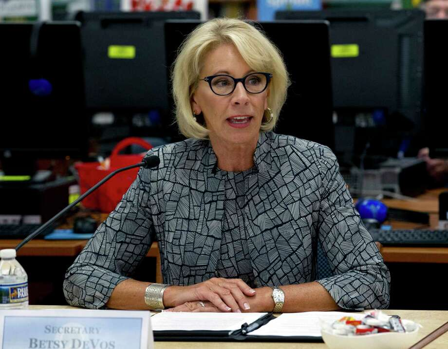 "FILE - In this May 31, 2018 file photo, Education Secretary Betsy DeVos speaks during a visit of the Federal School Safety Commission at Hebron Harman Elementary School in Hanover, Md.  DeVos says she has ""no intention of taking any action"" regarding any possible use of federal funds to arm teachers or provide them with firearms training. Her comments came Friday, Aug. 31, 2018 after a top official in her department, asked about arming teachers, said states and local jurisdictions always ""had the flexibility"" to decide how to use federal education funds. (AP Photo/Jose Luis Magana, File) Photo: Jose Luis Magana / FR159526 AP"