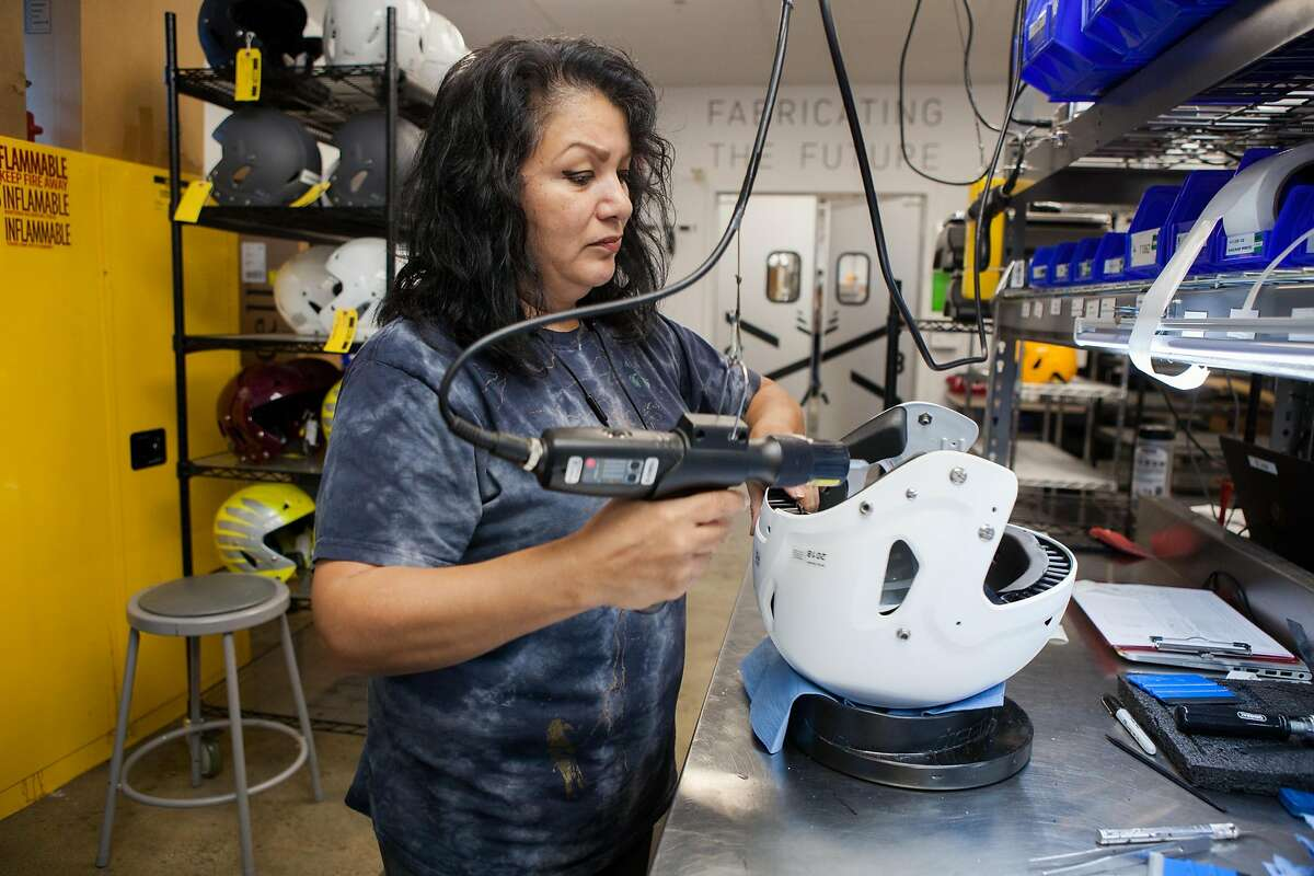 Marlene Gonzales works on initial assembly at football helmet manufacturing company VICIS�s production facility on Monday, Aug. 27, 2018 in Seattle, Wash..