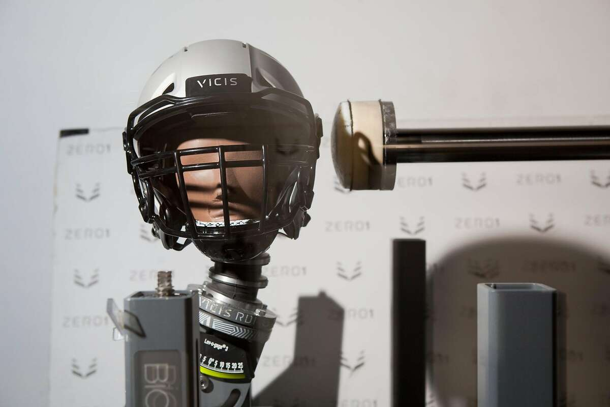 A helmet by football helmet manufacturing company, VICIS, undergoes impact testing in VICIS�s �Smash Lab� on Monday, Aug. 27, 2018 in Seattle, Wash..