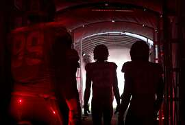 49ers players prepare to enter the field before the San Francisco 49ers game against the Dallas Cowboys at Levi's Stadium in Santa Clara, Calif., on Thursday, August 9, 2018.
