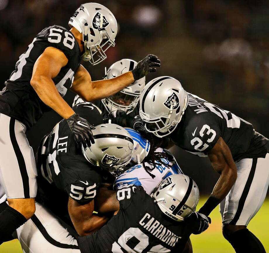 Detroit Lions running back LeGarrette Blount (29) is gang tackled by the Oakland Raiders during Week 1 of an NFL Preseason Game at the Oakland Alameda Coliseum, Friday, Aug. 10, 2018, in Oakland, Calif. Photo: Santiago Mejia / The Chronicle