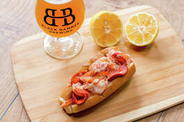 Lobster roll from Luke's Lobsters with a beer from Black Hammer Brewing.