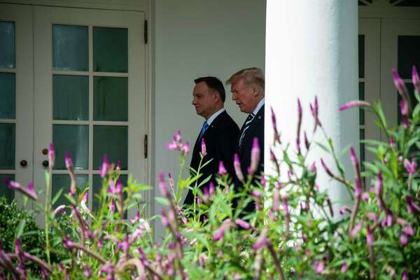 President Donald Trump walks to the Oval Office with Polish President Andrzej Duda on Tuesday during the leader's White House visit.