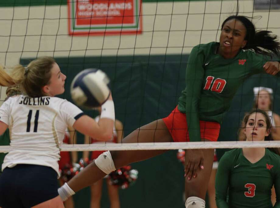 The Woodlands' Amanda Ifeanyi (10) scores past Klein Collins' Sam Normand (11) during the first set of a match Tuesday, Sept. 18, 2018 in The Woodlands. Photo: Cody Bahn,  Houston Chronicle / Staff Photographer / © 2018 Houston Chronicle