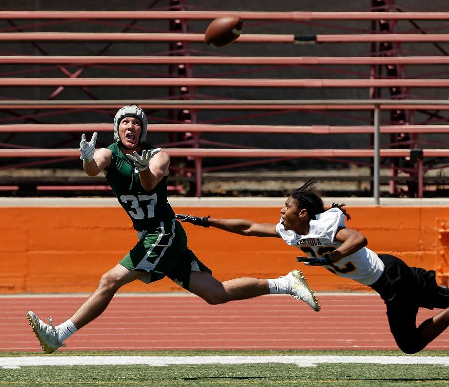 De La Salle's Grant Daley (37) goes for a catch pursued by Antioch's Ke'Sean Patton (32) during a 7-on-7, no pads or linemen tournament featuring 16 local high school teams at Pittsburg High School in Pittsburg, Calif., on Saturday, June 30, 2018. The tournament focused on technique and athleticism without the typical physicality of using linemen in order to prevent injury. Photo: Carlos Avila Gonzalez / The Chronicle