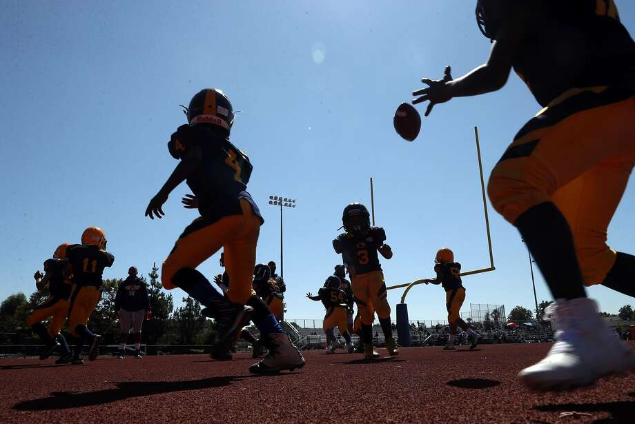 Berkeley Jr Bears Pop Warner Football Cadets warm up during football jamboree at Oak Grove High School in San Jose, Calif. on Sunday, August 26, 2018. Photo: Scott Strazzante / The Chronicle