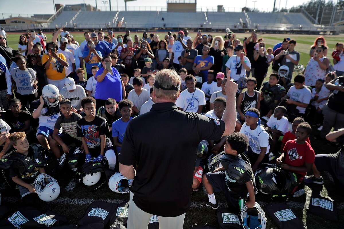 Oakland Raiders head coach Jon Gruden delivered equipment and encouragement to about 60 kids from the San Leandro Crusaders and the East Bay Panthers at Burrell Field in San Leandro, Calif., on Tuesday, July 17, 2018. The gear, and $50000 was a joint donation of the Dick's Sporting Goods Foundation and Coach Gruden.