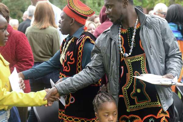 Members of First Presbyterian church gather for their annual outdoor worship in Albany's Washington Park. Dwight Cheu, of Glenmont, captured the congregation greeting each other, witnessing the baptism of a baby, taking communion, and listening to members from the Cameroons sing and drum. (Dwight Cheu)