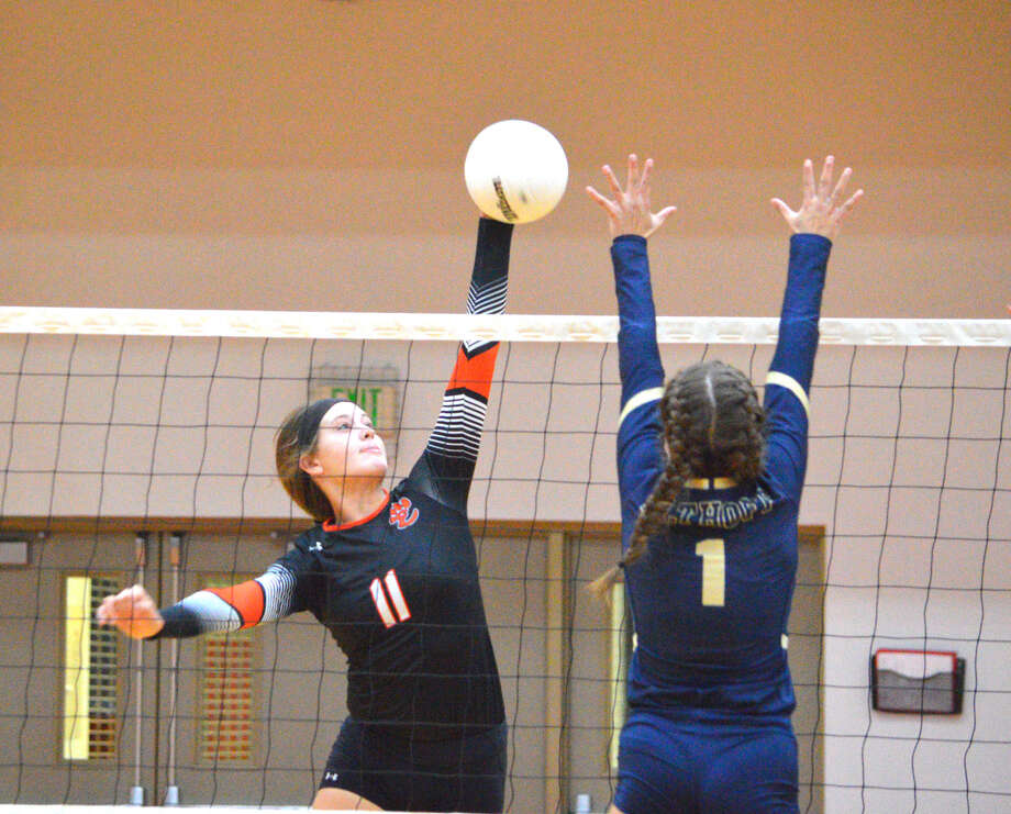Edwardsville freshman Gabby Saye, left, goes up for a kill during Tuesday's match against defending Class 3A champion Althoff at Lucco-Jackson Gymnasium. Photo: Scott Marion