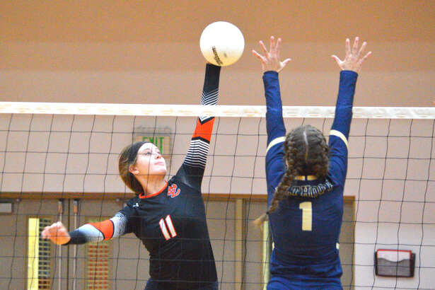 Edwardsville freshman Gabby Saye, left, goes up for a kill during Tuesday's match against defending Class 3A champion Althoff at Lucco-Jackson Gymnasium.