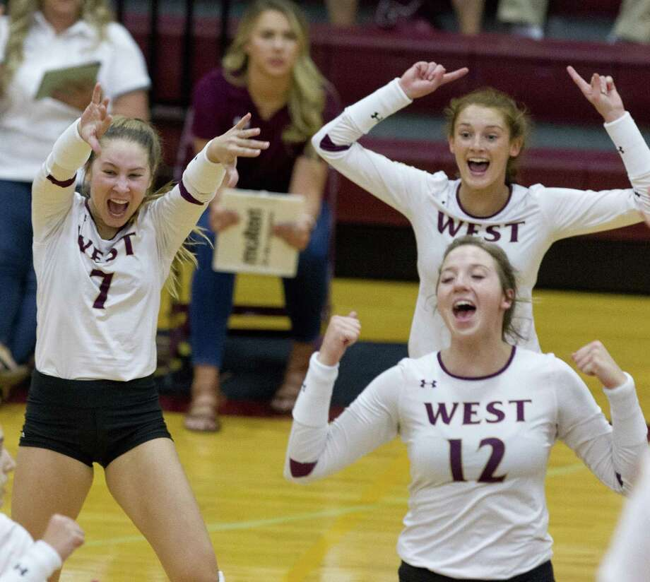 Magnolia West players react after a point during the second set of a non-district volleyball match at Magnolia West High School on Wednesday, Aug. 15, 2018, in Magnolia Photo: Jason Fochtman, Staff Photographer / Staff Photographer / © 2018 Houston Chronicle