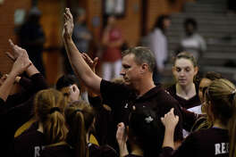 Lee volleyball head coach Robert Blakley talks to his team before the start of the second set against Amarillo Tascosa Sept. 18, 2018 at LHS. James Durbin/Reporter-Telegram