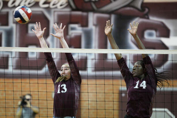 Lee's Jensen Letcher (13) and Loredana Fouonji (14) block against Amarillo Tascosa Sept. 18, 2018 at LHS. James Durbin/Reporter-Telegram
