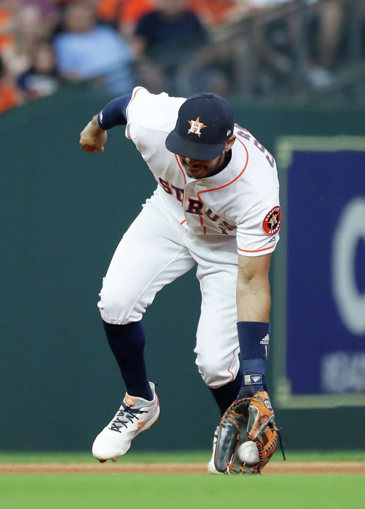 Houston Astros Carlos Correa (1) fields Seattle Mariners Nelson Cruz's ground out during the eighth inning of an MLB game at Minute Maid Park, Tuesday, September 18, 2018, in Houston.