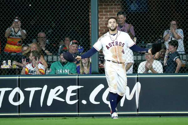 Houston Astros George Springer (4) gets up to thunderous applause after diving in an attempt to catch Seattle Mariners Robinson Cano's double during the eighth inning of an MLB game at Minute Maid Park, Tuesday, September 18, 2018, in Houston.