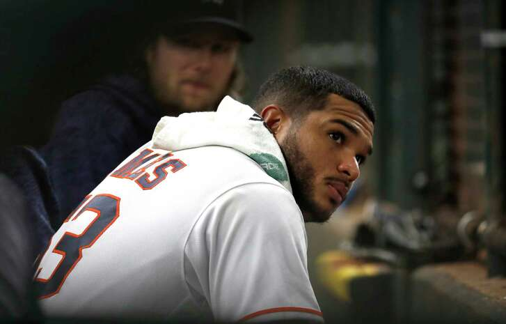 Houston Astros starting pitcher Josh James (63) sits in the dugout after getting pulled during the sixth inning of an MLB game at Minute Maid Park, Tuesday, September 18, 2018, in Houston.