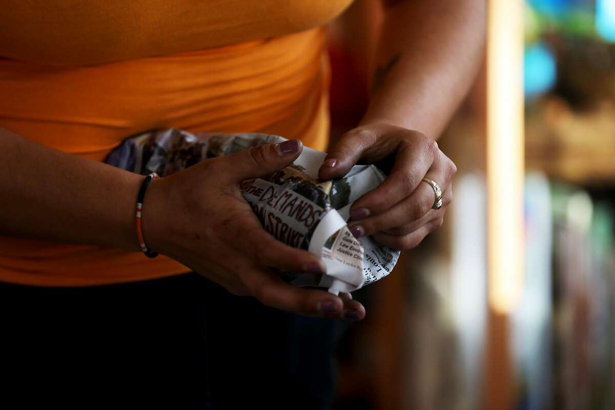 Juana Tello wraps a glass with newsprint and she and her family pack their belongings in their home of 18 years at 1778 Newcomb Ave., in the Bayview District, in San Francisco, Calif., on Tuesday, September 18, 2018. The family is facing a forced eviction, a battle they've been fighting for eight years. A new study shows the effects the Bay Area's astronomic housing costs are having on racial and ethnic groups. UC Berkeley researchers looked at the demographics of every neighborhood in the Bay Area from 2000 to 2015. Increases in housing prices intensified racial disparities in access to neighborhoods with better environmental quality, educational resources, and economic opportunities, increasingly placing these neighborhoods out of reach for low-income people of color in San Francisco, Alameda and Contra Costa counties.