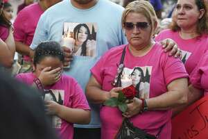 The family of Melissa Ramirez mourn their loss during a vigil Tuesday in Laredo.