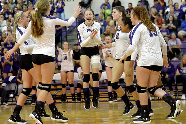 Port Neches-Groves celebrates as they continue their opening match advance over Nederland during their match-up at PNG Tuesday. Tuesday, September 18, 2018 Kim Brent/The Enterprise
