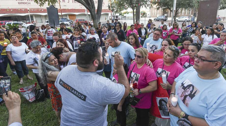 Family and friends of the four alleged victims of Juan David Ortiz gather at San Agustin plaza for a candlelight vigil on Tuesday, Sept. 18, 2018. Photo: Danny Zaragoza, Laredo Morning Times