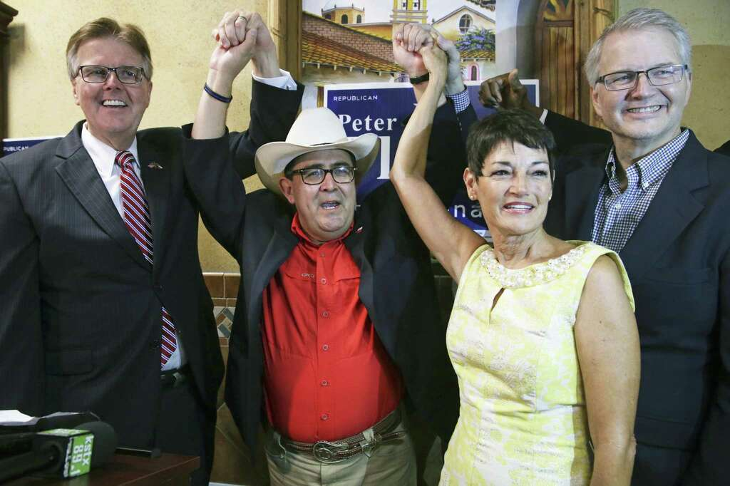 Pete Flores raises his hands in victory at Don Pedro restaurant as Lt. Governor Dan Patrick and Republican Party Chairman James Dickey celebrate during the Senate District 19 special election in San Antonio on September 18, 2018. State Senator Donna Campbell is in the front. Photo: Tom Reel, Staff / Staff Photographer / 2017 SAN ANTONIO EXPRESS-NEWS