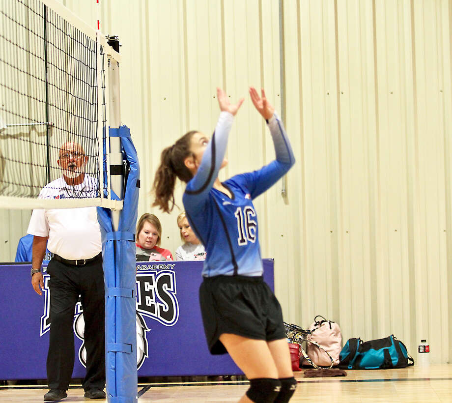 Plainview Christian Academy's Mia Stevens puts up a set for a teammate during the Lady Eagles TAPPS District 1-1A contest against Christ the King on Tuesday in Plainview. The Lady Eagles swept the Lady Trojans, 3-0. Photo: Photo Courtesy Of Don Brown