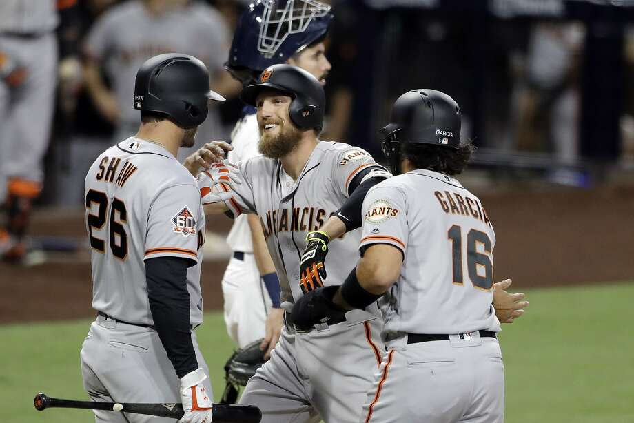 d6cbae39d San Francisco Giants' Hunter Pence, center, is greeted by teammates Aramis  Garcia (