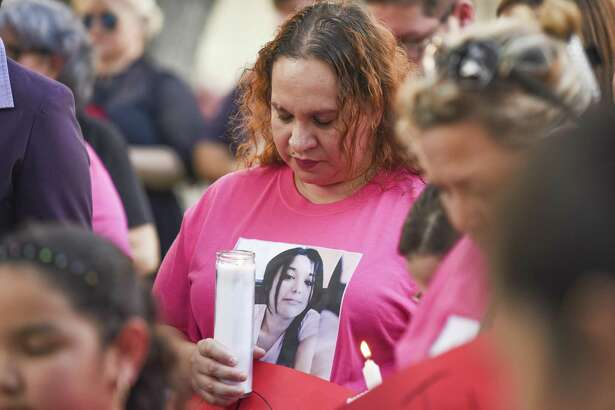 Family and friends of the four alleged victims of Juan David Ortiz gather at San Agustin plaza for a candlelight vigil on Tuesday, Sept. 18, 2018.