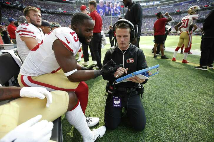 Pierre Garcon and wide receivers/passing game specialist Mike LaFleur of the 49ers talk on the sideline during the Week 1 lost to the Vikings in Minnesota.