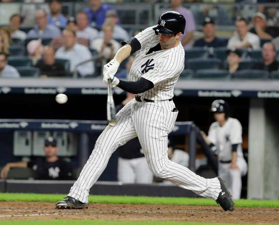 New York Yankees' Neil Walker hits a three-run home run during the seventh inning of the team's baseball game against the Boston Red Sox on Tuesday, Sept. 18, 2018, in New York. (AP Photo/Frank Franklin II) Photo: Frank Franklin II / Copyright 2018 The Associated Press. All rights reserved.