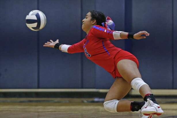 Jefferson's Andrea Valdez dives for the ball from the District 27-5A high school volleyball match between Jefferson and Edison on Tuesday, September 18, 2018 at Alamo Convocation Center.
