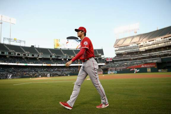 OAKLAND, CA - SEPTEMBER 18:  Shohei Ohtani #17 of the Los Angeles Angels walks back to the dugout before their game against the Oakland Athletics at Oakland Alameda Coliseum on September 18, 2018 in Oakland, California.  (Photo by Ezra Shaw/Getty Images)