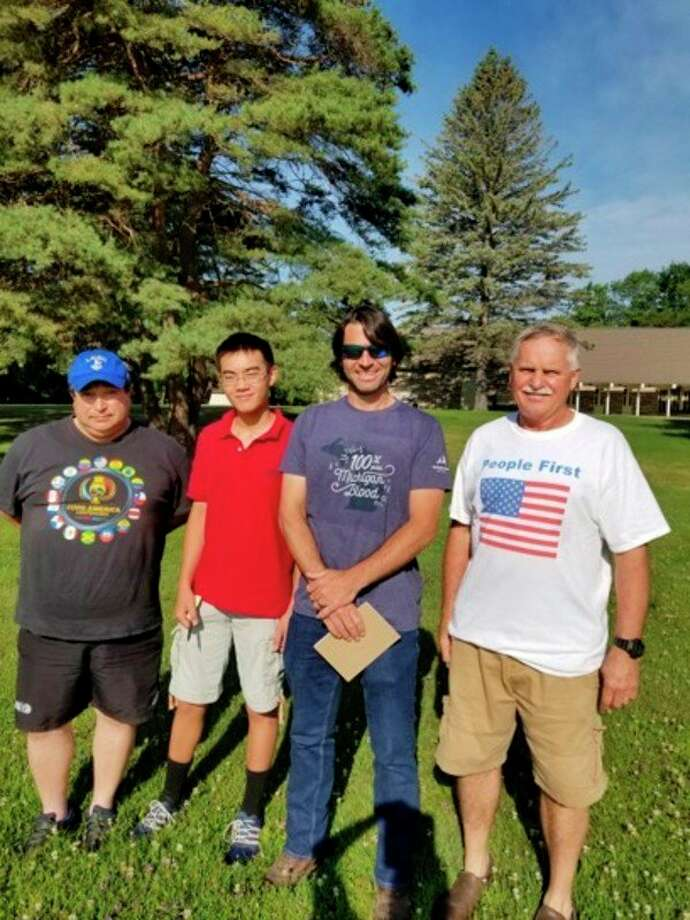 From left, Rico Barrassi; Andrew Zhou, Eagle Scout candidate; Travis Keeton with the Midland Parks Department; and Ziggy Kozicki are working to develop a community wellness park with a walking path, park benches and soccer field at Shipps Family Park in Midland. (Photo provided)