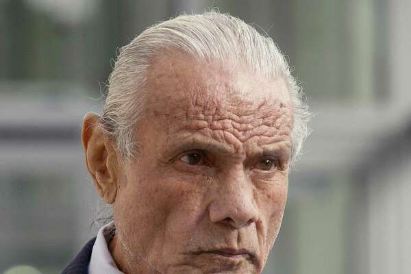 "FILE - In this Nov. 2, 2015, file photo, former professional wrestler Jimmy ""Superfly"" Snuka leaves Lehigh County Courthouse in Allentown, Pa. More than 50 former professional wrestlers sued World Wrestling Entertainment Inc., saying the company is responsible for repeated head trauma including concussions they suffered in the ring that led to long-term neurological damage. Snuka, Joseph ""Road Warrior Animal"" Laurinaitis and Paul ""Mr. Wonderful"" Orndorff are among the plaintiffs who filed the lawsuit Monday, July 18, 2016, in federal court in Connecticut. Snuka died in 2017. (Michael Kubel/The Morning Call via AP, File)"