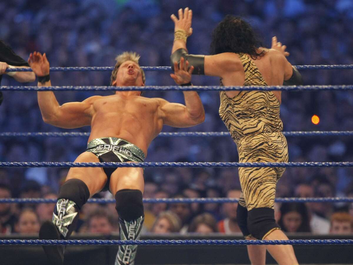 Chris Jericho, left, goes down after being hit by Jimmy