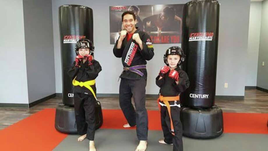 Coach Steven Decatur with two of his martial art students. (Photo provided)