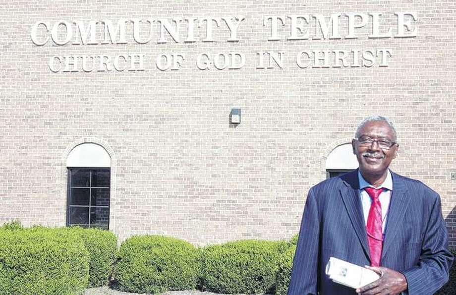 Pastor Samuel Holmes stands Monday outside Community Temple.