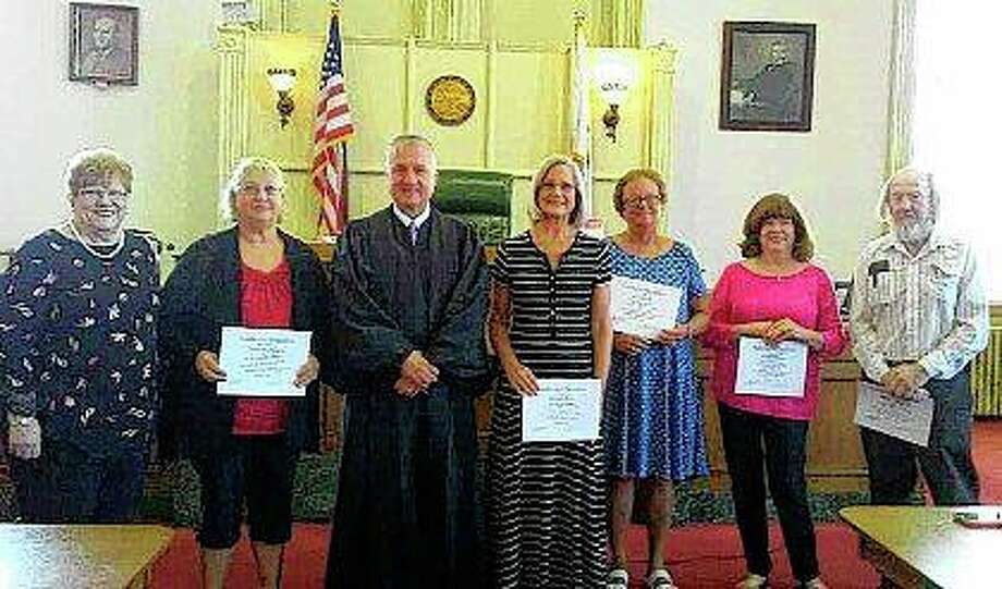 New court-appointed special advocates for Morgan County — joining coordinator Libby Gaige (left) — are Joann McManus (second from left), Wanda Dame (center), Lyn Dietz, Jeanie Brown and Ralph Langford. They were sworn in by Judge Jeffery Tobin (third from left). Photo: Photo Provided